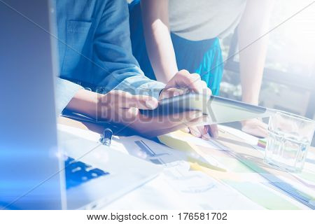 Closeup view of female hands holding modern digital tablet.Girl pointing the screen with your finger.Concept business people working with mobile devices.Visual effect, flares, blurred background