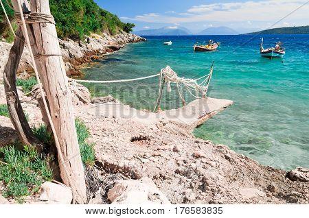 Concrete pier and two litlle boats on the Ioian island Lefkada