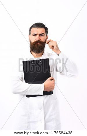 Bearded man long beard. Brutal caucasian doctor or unshaven hipster postgraduate student holding clipboard in medical gown isolated on white studio background. Medicine concept