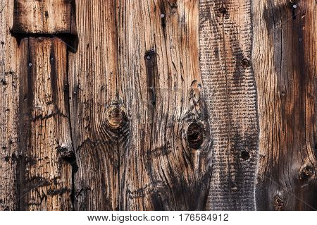 Wooden background from old planks. Well seen rich texture of the ravaged wood.