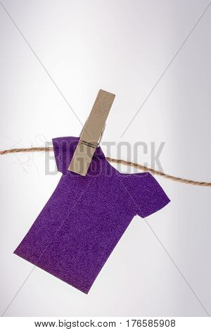 Paper Clothes Hang On A Rope With Clothespins