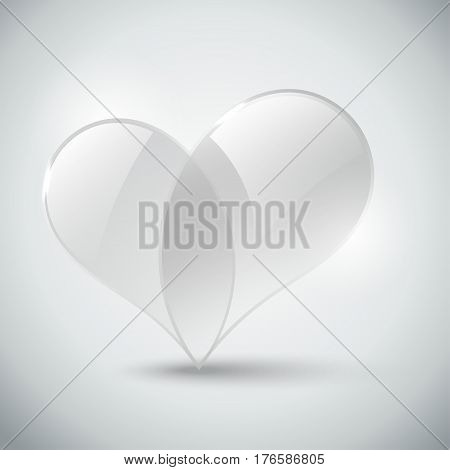 Glass Heart on a gray background with a shadow.
