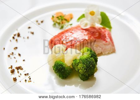 The red snapper with vegetable. Shallow dof