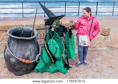 Participant Of Festival Dressed As Witch Gives The Girl Candy