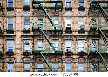 Windows and fire escape on an old brick building in the historic Greenwich Village neighborhood of Manhattan New York City NYC