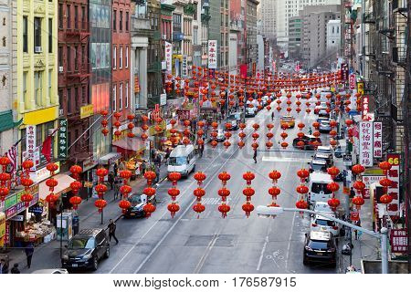 NEW YORK CITY - FEBRUARY 24: The colorful streets of Chinatown are crowed with stores restaurants signs cars and people in Manhattan on February 24 2017.