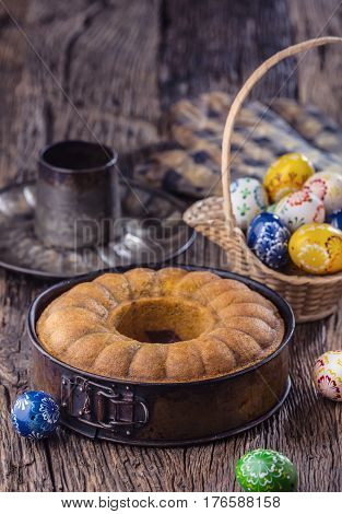Marble cake.Easter Cake.Marble cake cup of coffee powder sugar kitchen vintage utensil and easter eggs.
