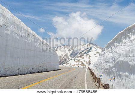 Empty road and snow wall at japan alps tateyama kurobe alpine route