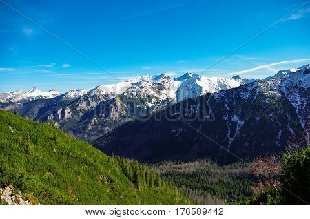 Autumn landscape of great peaks covered with snow. Tatry.