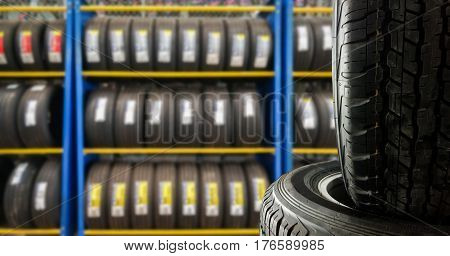 blurred tires showing on shelf for sell or fix in the shop