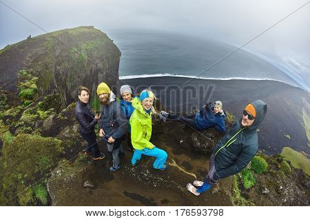 Rreykjavik, Iceland - August 29, 2016: Tourists setting on Dyrholaey Cliff Iceland