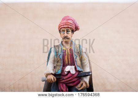 Ottoman Man  Figurine In View On A Brown Backgorund