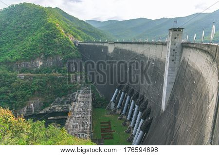 The Bhumibol dam  is a concrete arch dam on the Ping River in Tak, Thailand.