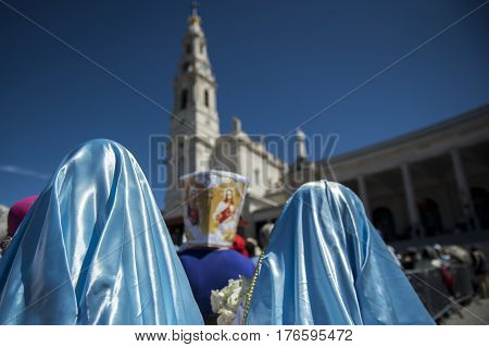 Fatima Portugal - May 13 2014: People at the Sanctuary of Fatima during the celebrations of the apparition of the Virgin Mary in Fatima Portugal.