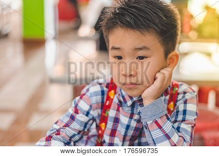 Little Boy is lonely sad and boring.