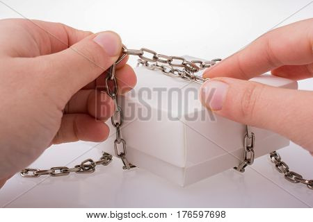 White Gift Box With Chain In Hand