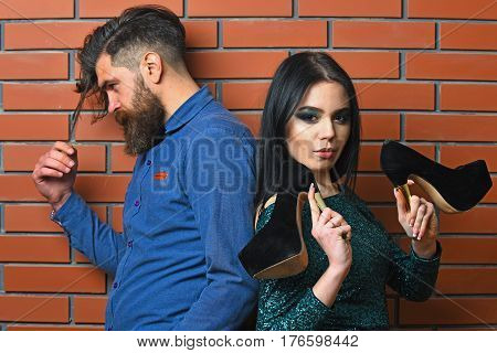 Bearded Man And Pretty Sexy Woman With Shoes