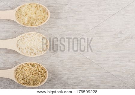 Wooden Spoons With Parboiled, Polished, Brown Rices From Left Side