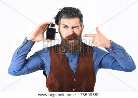 Bearded Man Holding Perfume With Satisfied Face