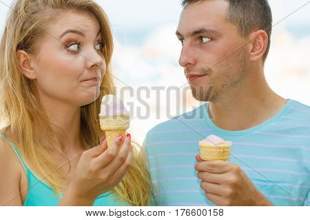 Man And Woman Eating Ice Cream On Beach