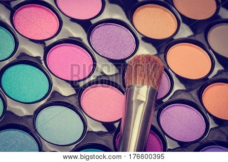 Colorful make-up eyeshadow palette with make-up brush