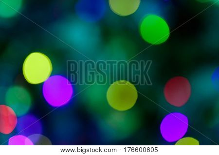 Defocused lights background. Colorful blurred lights with copy space
