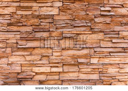 Stone brick wall background or texture. Stone fence outdoors