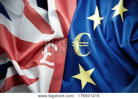 UK and European flag together with currency symbols