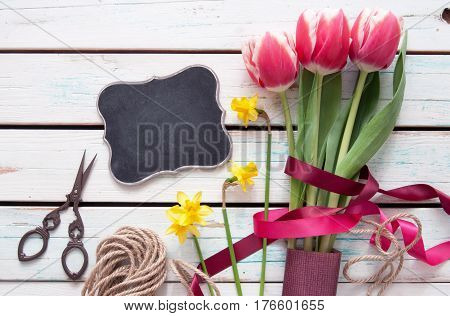 Spring tulip bouquet with small blackboard sign