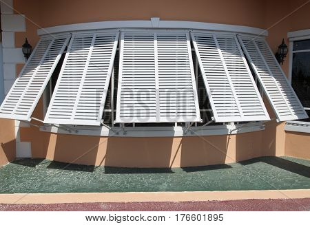 The round window shutters in Nassau city building (The Bahamas).