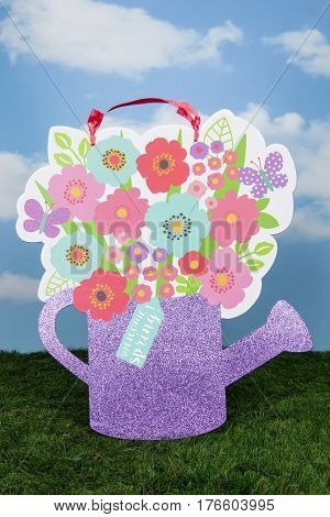 A watering can sign for welcoming spring
