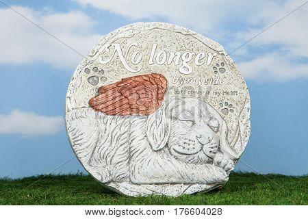 A dog memorial stone for the lawn or garden