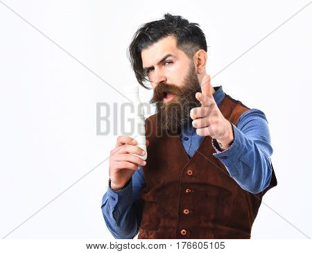 bearded man long beard brutal caucasian hipster with moustache holding bottle of kefir or yoghurt with serious face isolated on white background
