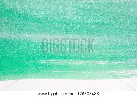 Macro shot of abstract hand drawn green watercolor paints background