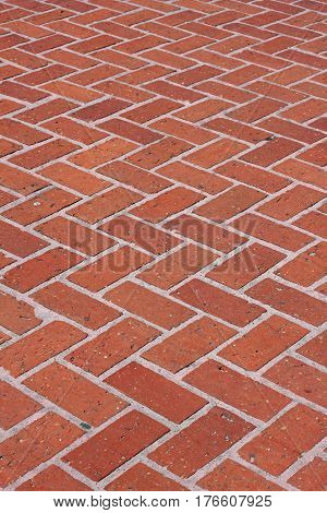Red Brick Walkway with a Zigzag Pattern