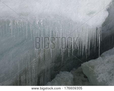 Icicles on the edge of a glacier next to Cho La mountain pass Nepal.