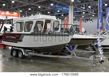 MOSCOW - MARCH 09 2017: Boat Victory 630 Cabin PRO for 10 International boat show in Moscow. Russia.