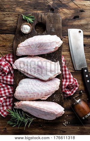 Raw turkey wings on wooden background top view flat lay