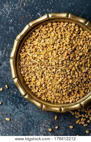 Fenugreek seeds on metal plate spice culinary ingredient