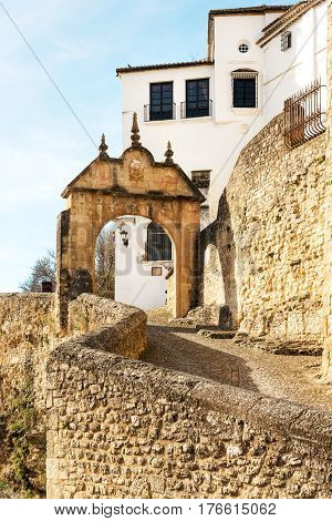 Philip V City Gates (Arch) and city wall in historic Ronda, Spain