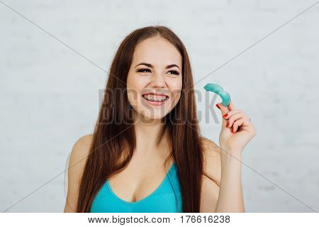 Girl Boxer With Braces Holding Gloves And Cape
