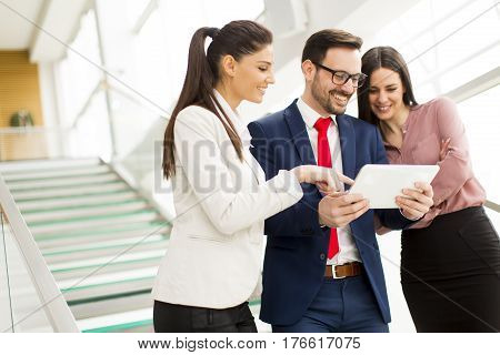 Smiling Business Team Working On Tablet Pcs