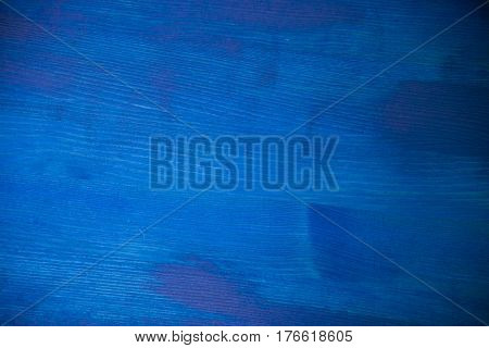 Navy blue wood texture. Navy blue wood background. Closeup view of blue wood texture and background. Abstract background and texture for designers. Texture of vintage handmade table. Rustic table.