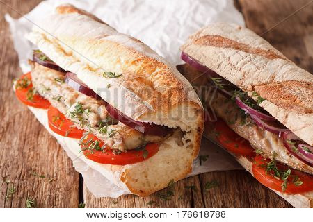 Sandwiches With Fried Mackerel And Vegetables Close-up. Horizontal