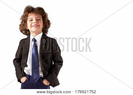 Little boy in a business suit smiles broadly narrowed eyes. White background.