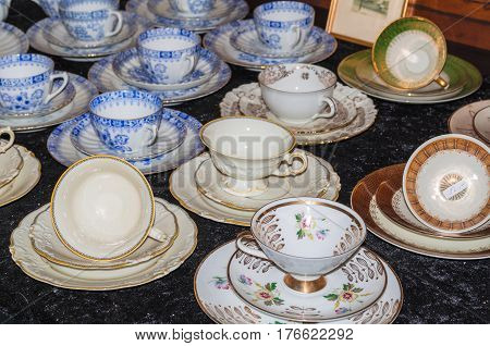 SOLINGEN NRW GERMANY - JULY 15 2015: Old porcelain cups with different design an antique shop