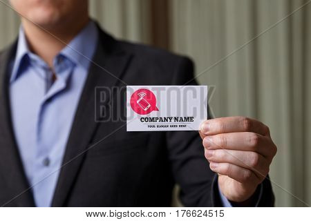 Businessman holding visit card. Man showing blank business card with company name text. Person in black suit. Mock up design.