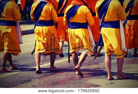 Soldiers With Orange Clothes March Through The City During A Fes