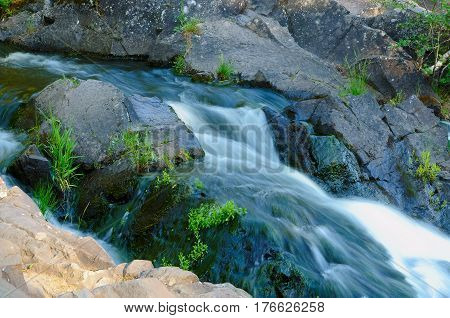 The mountain stream flowing over the rocks