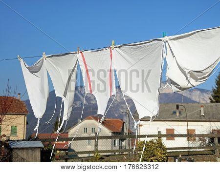 Washed White Aprons They Dry In The Hot Sun In A Village